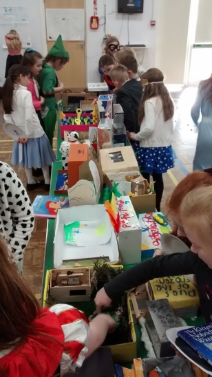 Children inspecting Book in a Box entries