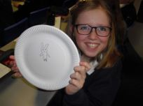 Girl with plate portrait Green Lane Primary Mar 18