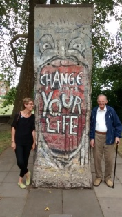 Ally and her dad, standing next to a piece of the Berlin Wall